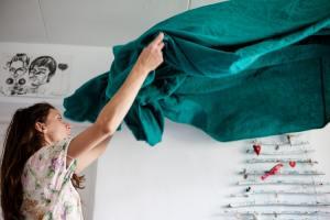 A woman folding laundry.