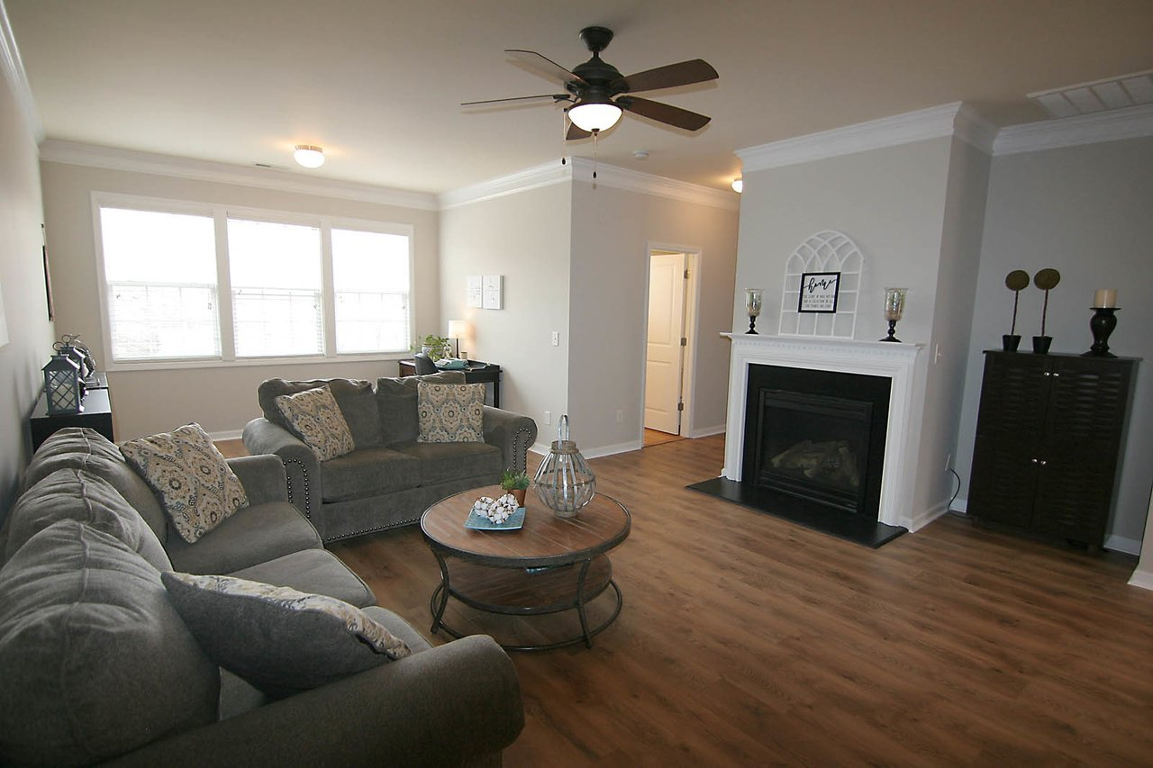 spacious family room with bonus flex area in an apex townhome