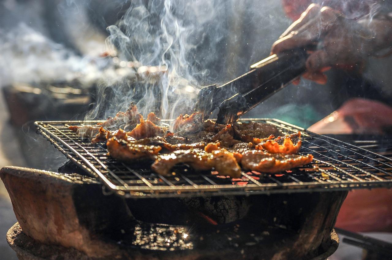 barbecue cooking at apex peak city pig fest