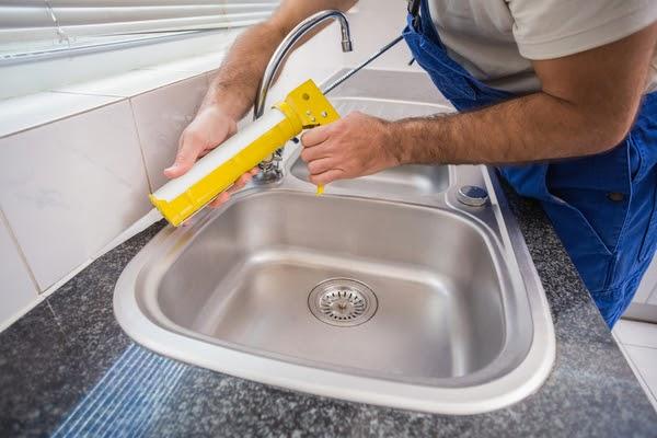 caulking kitchen tiles around sink