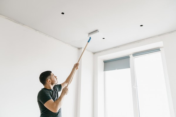 handyman painting a ceiling