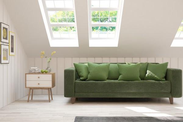 rearrange furniture green sofa