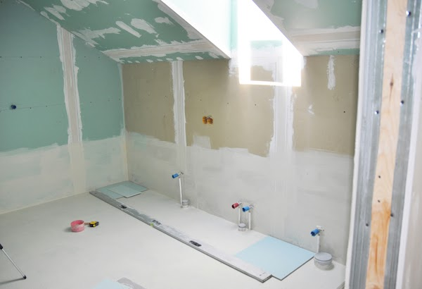 drywall and painting during bathroom renovation