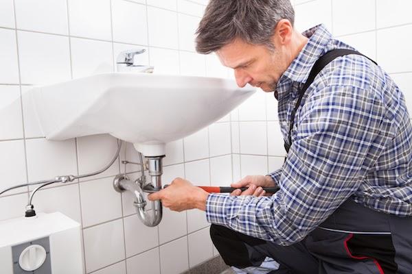 plumber working on bathroom reno