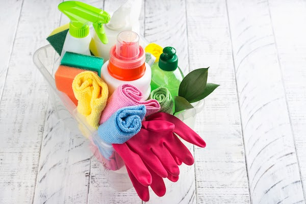 basket of cleaning supplies for a spotless bathroom