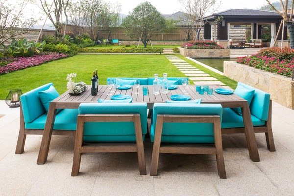 dining table with place settings backyard