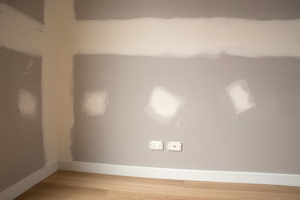 spot touching drywall with spackle
