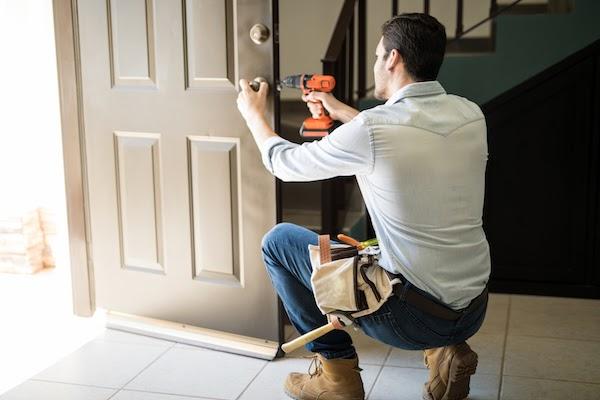 handyman fixing front door