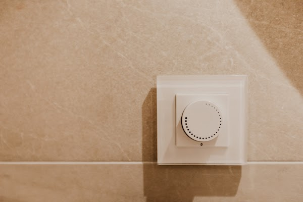 close up of bathroom lighting dimmer switch