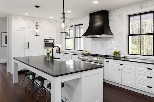 black countertops in all white kitchen