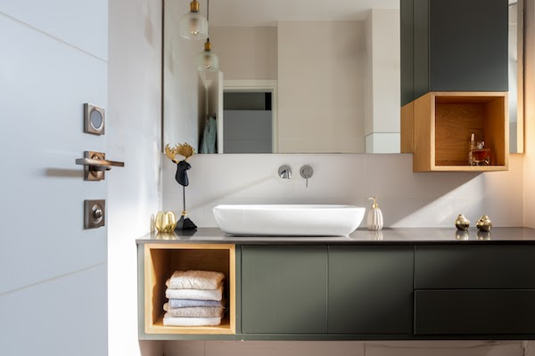 soft green bathroom with storage