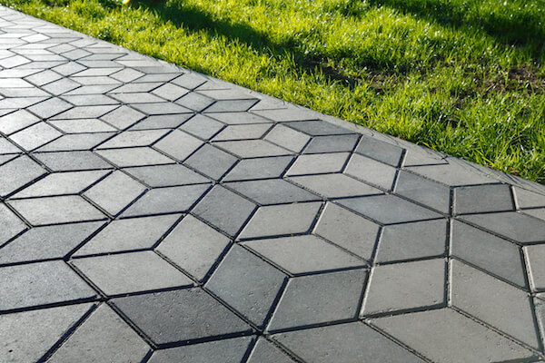 beautiful grey interlocking stone patio
