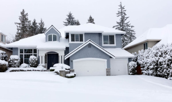home in winter with snow
