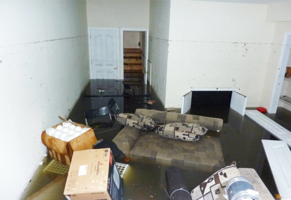 Furniture floating in flooded basement
