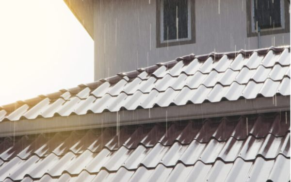 Rain on the metal roof with sunlight