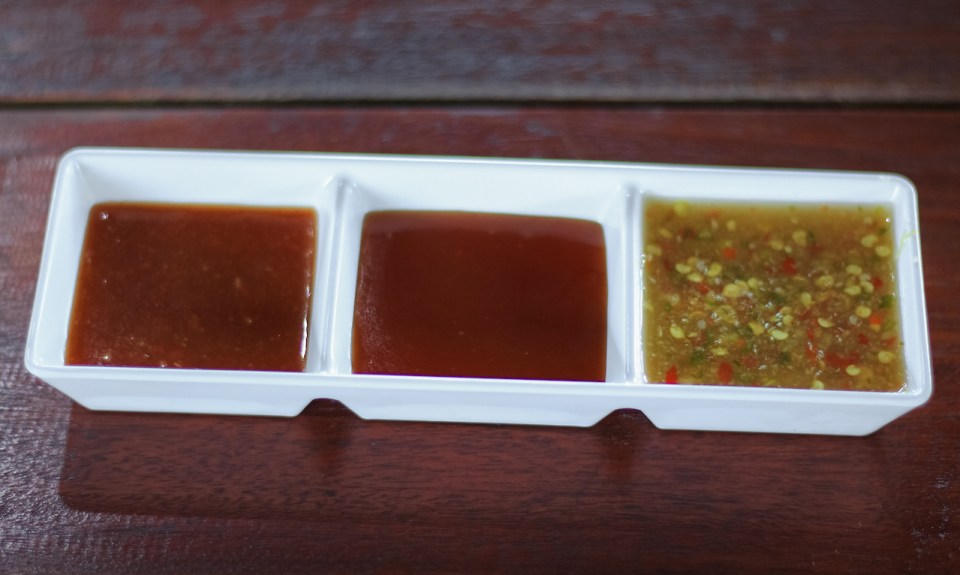 seafood sauce with tomato sauce and suki sauce in a dish on a table background