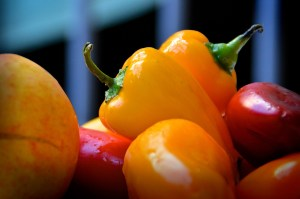 close up of orange and red peppers, farming food concept
