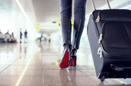 Woman walking with a suitcase in the airport