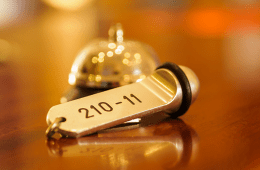 Hotel key next to a bell