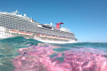 Person floating in Caribbean water after getting kicked off a cruise ship. Just kidding.