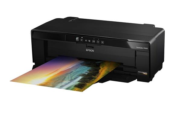 What is the difference between a laser printer and an ink-jet printer?