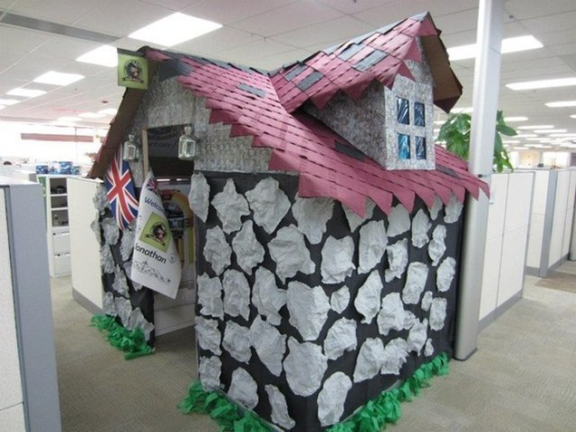 paper mache house covering coworkers cubicle