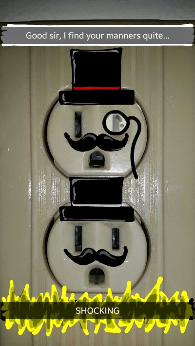 """Funny Snapchat drawing of electrical outlets with hats and mustaches with the caption """"Shocking"""""""