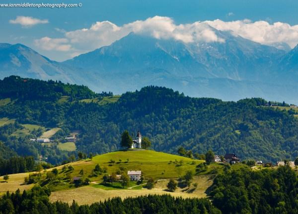 View across to Sveti Tomaz nad Praprotnim (church of Saint Thomas) in the Skofja Loka hills, Slovenia.