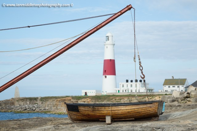 Lighthouse at Portland Bill and the old boat winch in the early morning sun, near Weymouth, Jurassic Coast, Dorset, England.