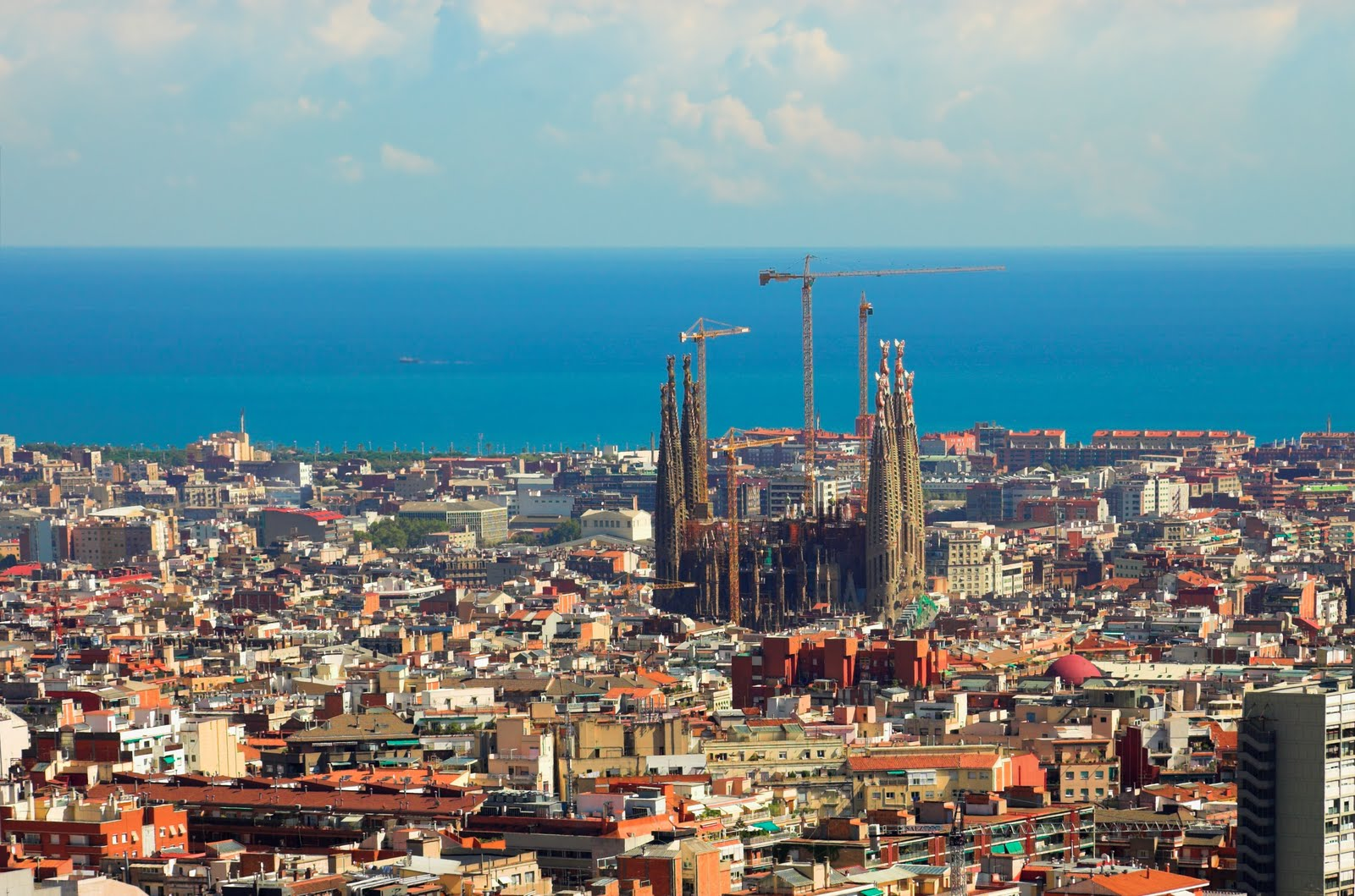 Barcelona and the Familia Sagrada towering over the city. It's been under construction for over a century. (photo from blog.iese.edu)