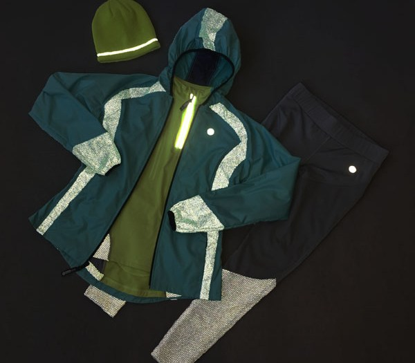 Reflective jacket, pants, pullover, and hat shown in low light conditions to demonstrate reflectivity.