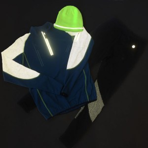 Reflective men's pullover, pants and hat shown in low light to demonstrate reflectivity
