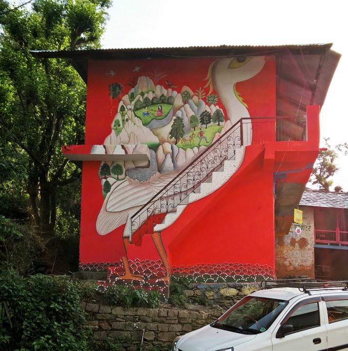 Gargi Chandola mural wall artred background crane in a village
