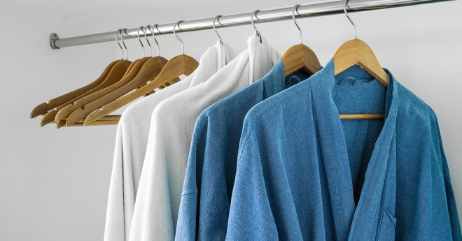 Bathrobes on hangers in closet