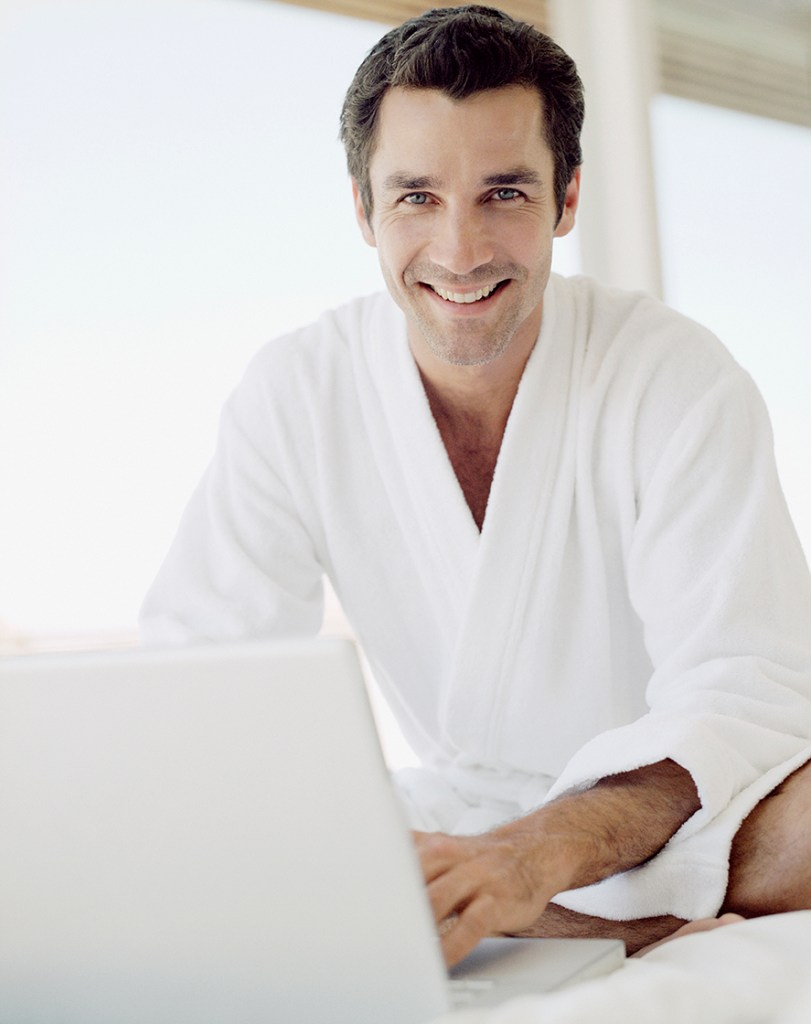 Man working from home in bathrobe