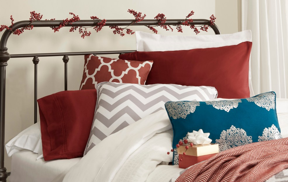 iNSPIRE Q decorative holiday headboard with faux berry vine tied around posts