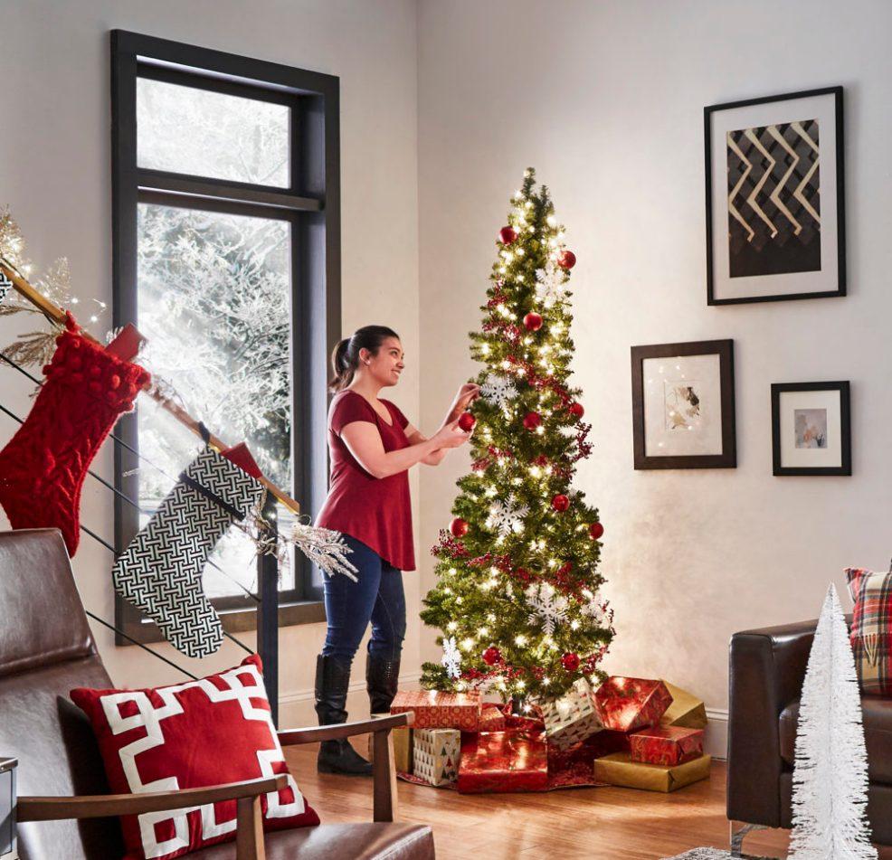 woman decorating christmas tree iNSPIRE Q modern christmas loft