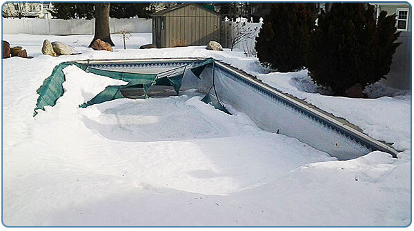 with snow on your winter pool cover