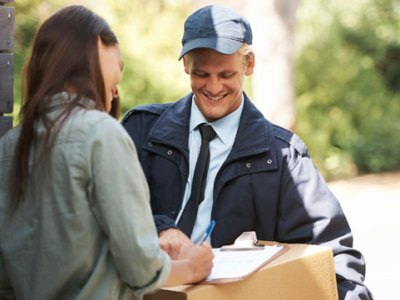 Deliveryman Getting Signature on Package