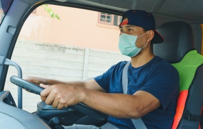 Truck driver wearing a mask to protect against Covid19