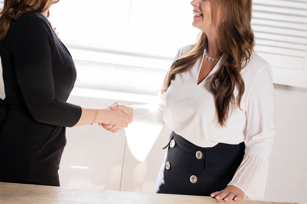 two women negotiating a business deal