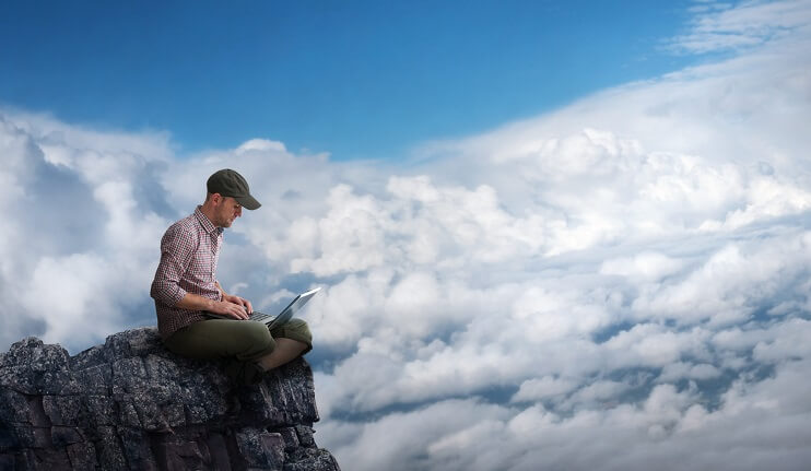 Man working from top of mountain