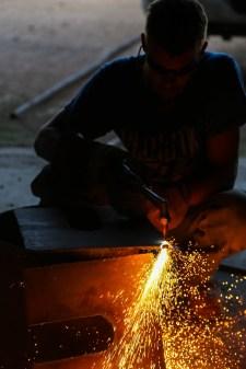 My brother, John, cutting metal