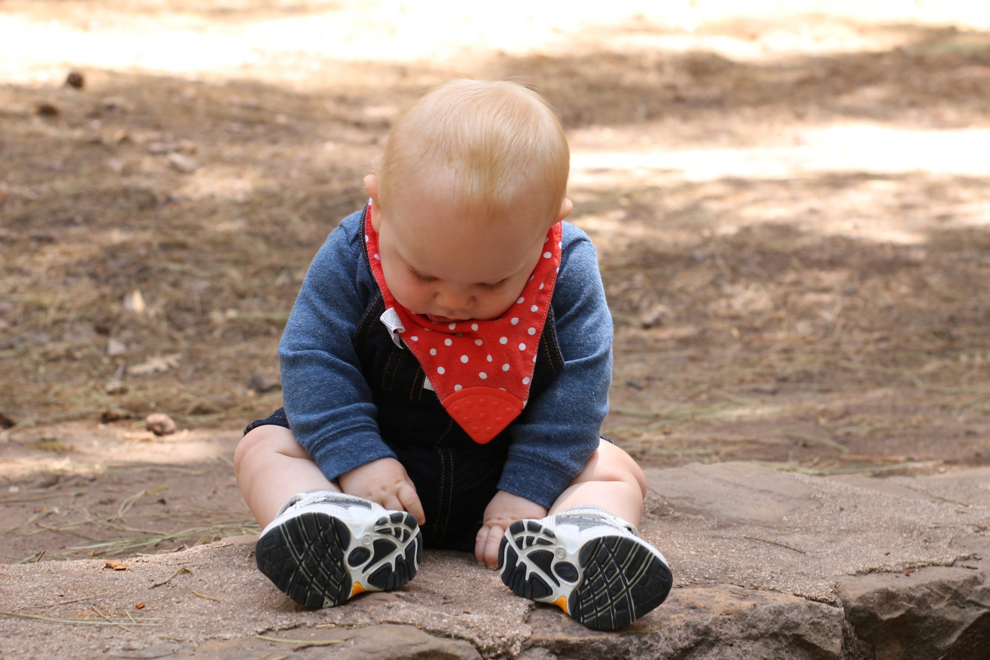 Photo of my young son sitting on a rock.