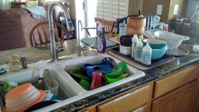 This is our kitchen with over two days' worth of dirty dishes in the sink and counter.