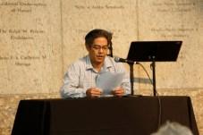 Kurt Kuniyoshi reading Nisei Poet, Hiroshi Kashiwagi's redress testimony. Photo by Russell Kitagawa.