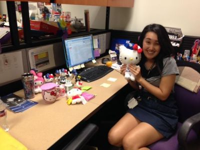 Liz shares a desk with Hello Kitty while planning a full schedule of public programs for the museum.