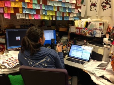 Hello Kitty has managed to squeeze in to Production Manager Vicky's busy desk. Look closely at the pen in hand!