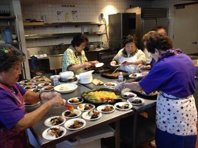 JANM volunteers work hard to prepare the osechi-ryori tasting every year.