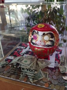 This Daruma, situated in the JANM lobby, helps attract money to support the museum's programs.